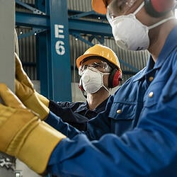 Warehouse workers wearing PPE